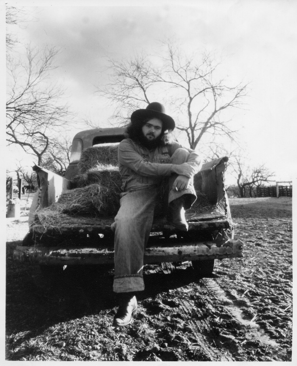 B. W. Stevenson, sitting on the bed of a pickup truck