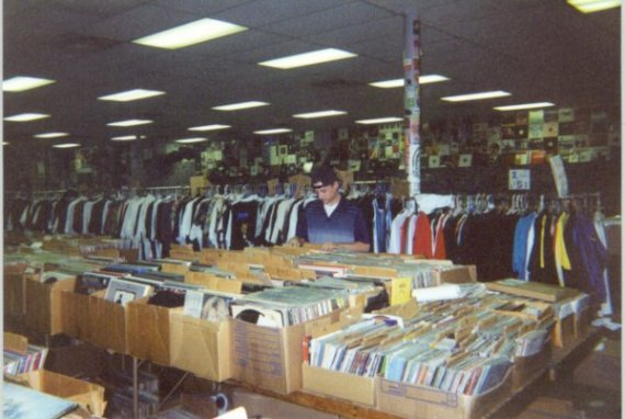 Picture of some of their LPs. Young man is a store employee.